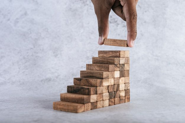 stacking-wooden-blocks-is-risk-creating-business-growth-ideas_1150-19611